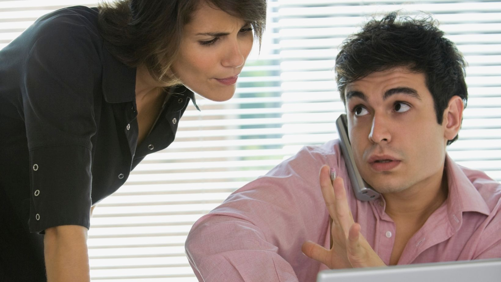 Woman interrupts busy coworker